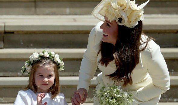 Kate with bridesmaid Charlotte at Harry and Meghan's wedding in May (Image PA Wire PA Images)