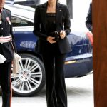 Meghan looked stylish in a black trouser suit Photo (C) GETTY
