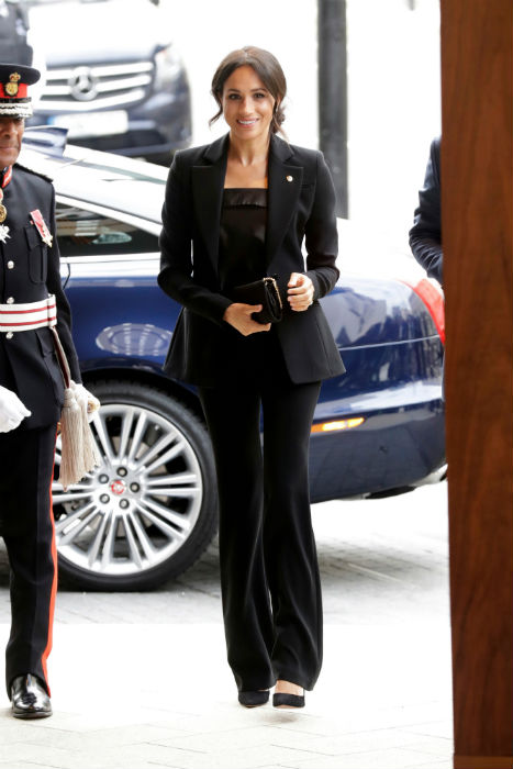 Meghan looked stylish in a black trouser sMeghan looked stylish in a black trouser suit Photo (C) GETTYuit Photo (C) GETTY