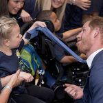 Prince Harry Harry goofs around with a young attendee (Image PA)