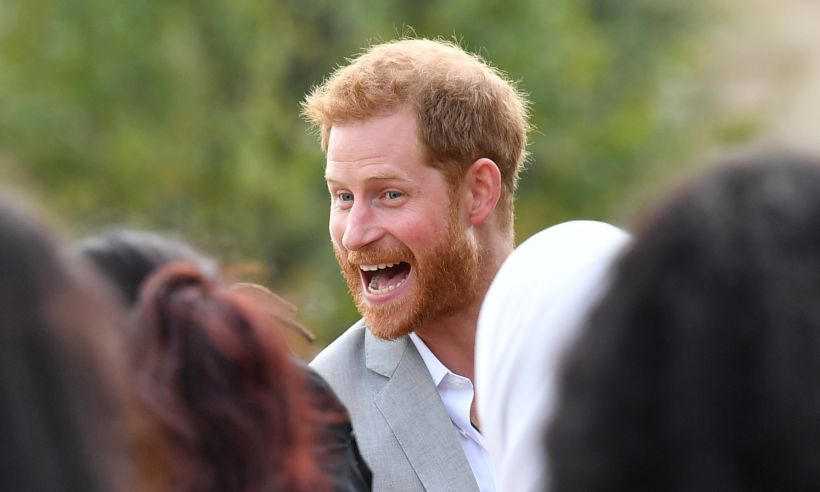 See the moment cheeky Prince Harry was caught stealing samosas from Meghan's cookbook launch Photo (C) GETTY