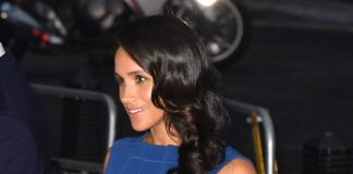 The Duchess of Sussex ditched her go-to messy bun in favour of seriously shiny curls at the charity concert. Source PA