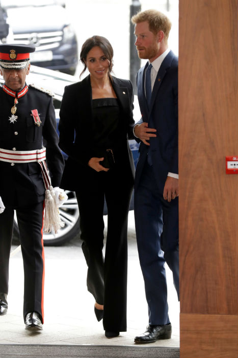 Meghan looked stylish in a black trouser sMeghan looked stylish in a black trouser suit Photo (C) GETTYuit Photo (C) GETTY