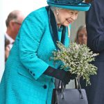 The Queen looked smart in a blue outfit for the outing (Image WENN)