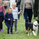 The little girl helped to walk Princess Anne's dog Photo (C) GETTY