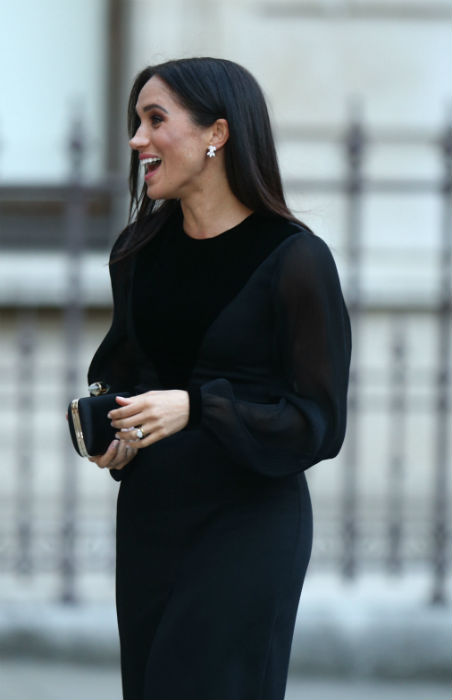The royal teamed her dress with a co-ordinating clutch Photo (C) MEGHAN MARKLE