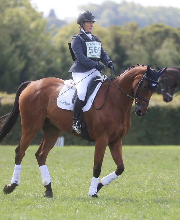 Mia was pictured larking about while watching her famous mother compete in horse trials (Image SWNS)