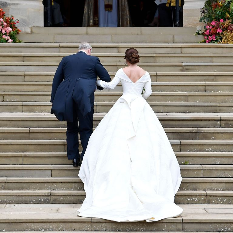 1 Princess Eugenie made a powerful decision to show her scars from scoliosis surgery in her wedding day look Photo C GETTY