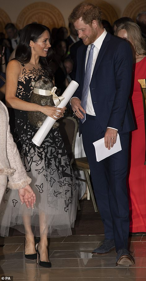 1 The Duchess holds a scroll and a toy wombat Ironically Prince William was nicknamed wombat by his mother Princess Diana