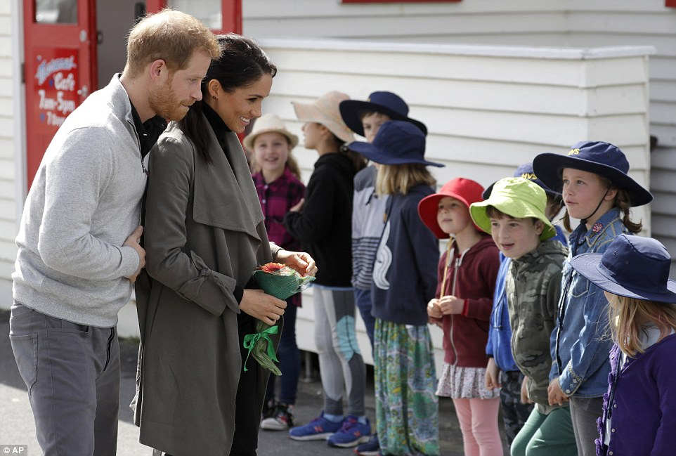 The Duke and Duchess of Sussex step out from Wellingtons Maranui Cafe on day two of the royal tour of New Zealand