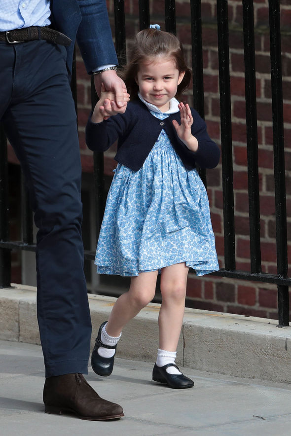 Charlotte mastered the Windsor Wave - her left arm is angled at 90 degrees, moving her hand gently (Image GETTY)