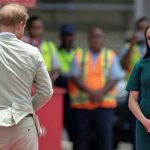 Clearly love struck Meghan was photographed looking towards her husband several times Image Getty