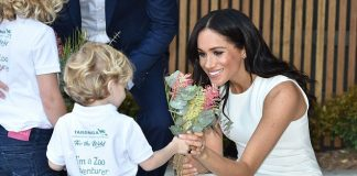 Dasha was invited along with Finley Blue pictured handing his bouquet to Meghan as planned to give a bunch of native flowers to the royal couple during their visit to Taronga Zoo