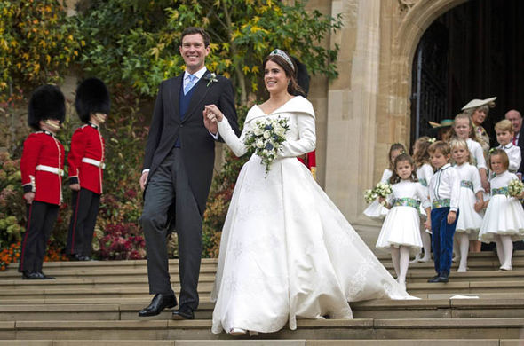 Eugenie and Mr Brooksbank beamed as they left St Georges Chapel Image PA