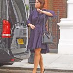Eugenie played with her hair as she crossed the road in London Photo C GETTY