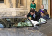 Eugenie was helped into the Aston Martin as she left Windsor Castle Image PA