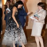 Harry and Meghan share a joke as the Duchess looks at her heels while they attend the Australian Geographic Society awards