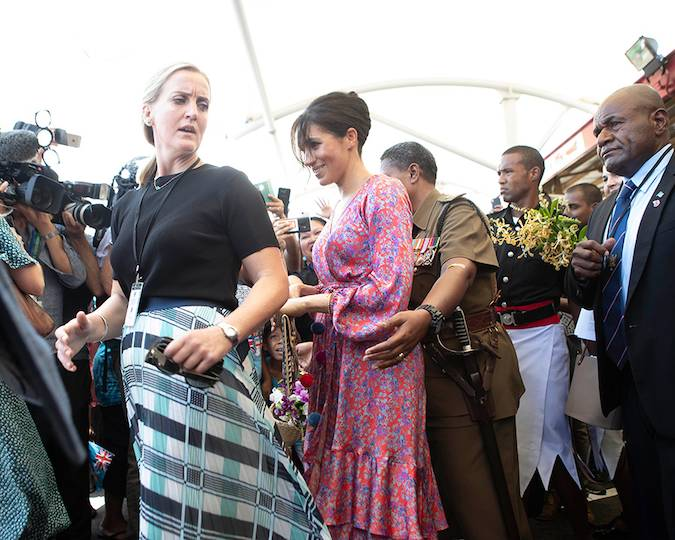 In a particularly dramatic moment of the tour Meghan had to be ushered away from her last public engagement in Fiji Photo C GETTY