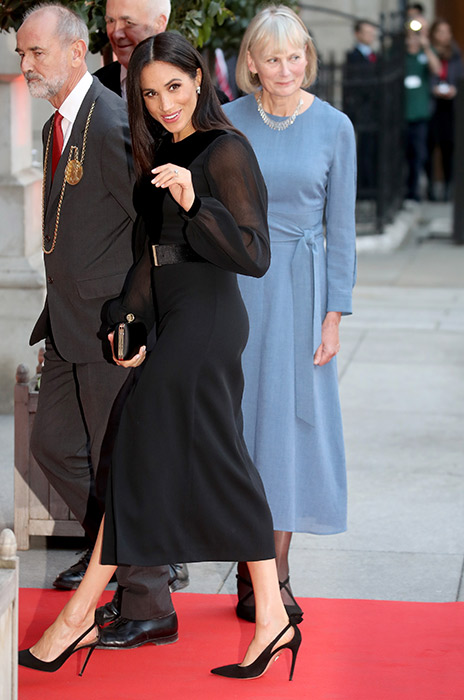 But the rumour mill started swirling in October when Prince Harrys wife stepped out in a tight leather skirt in Sussex Photo C GETTY
