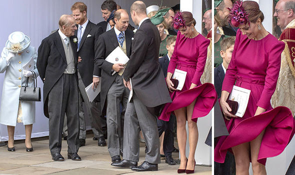 Kate flashed her legs when a huge gust of wind courtesy of Storm Callum whooshed her skirt up Image GETTY