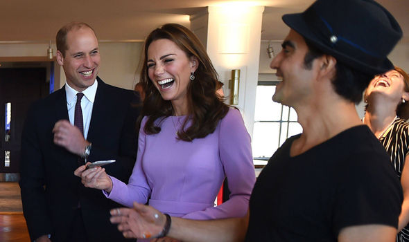 Kate laughed as she helped with a painting Image AFP GETTY