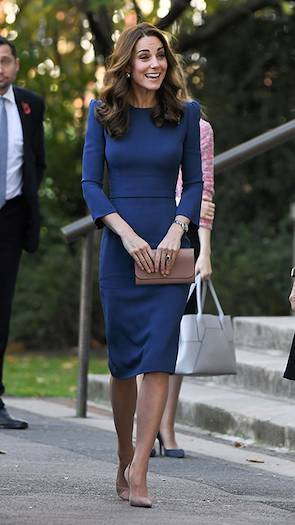 Kate looked typically elegant for her museum outing recycling a royal blue Jenny Packham dress that she previously wore on a tour of Canada Photo C GETTY