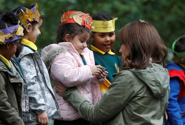 LONDON, ENGLAND - OCTOBER 02: Catherine, Duchess of Cambridge hugs Amwaar, age 4, as she leaves Sayers Croft Forest School and Wildlife Garden on October 2, 2018 in London, England. Sayers Croft is an activity centre aimed at educating and involving children and the local community in the environment. (Photo by Peter Nicholls - WPA Pool/Getty Images)