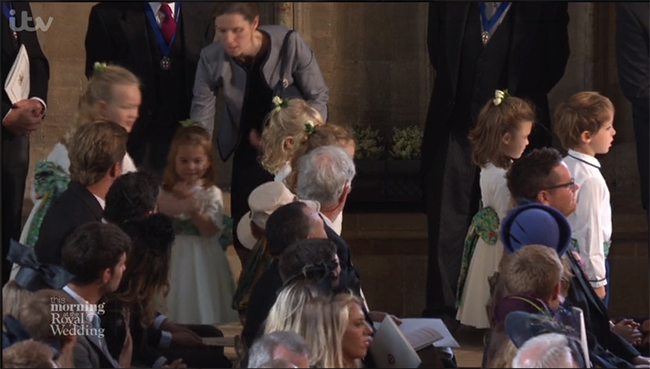 The royal nanny also handed the children their bouquets Photo C GETTY