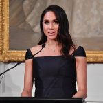 Meghan 37 stunned in a navy cocktail dress by New York based Gabriela Hearst modified to include delicate cap sleeves