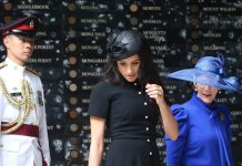 Meghan Duchess of Sussex paired the classy dress with a fascinator and pointy shoes Getty
