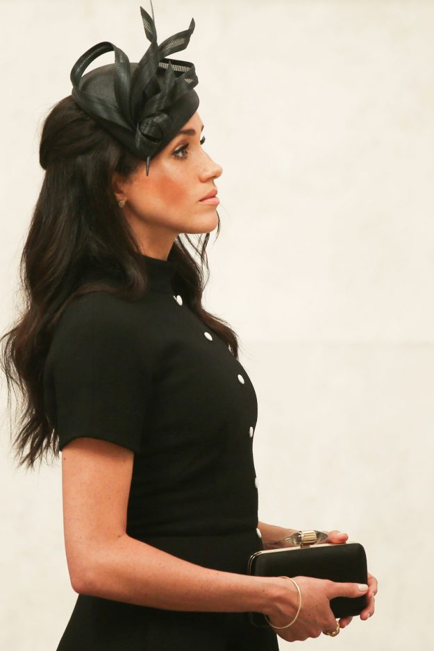 Meghan Duchess of Sussex wore a form fitting dress that shows her tiny bump Getty