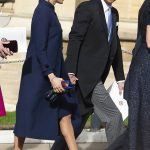 Meghan Markle The Duchess wore a long and loose fitting navy coat Image EPA