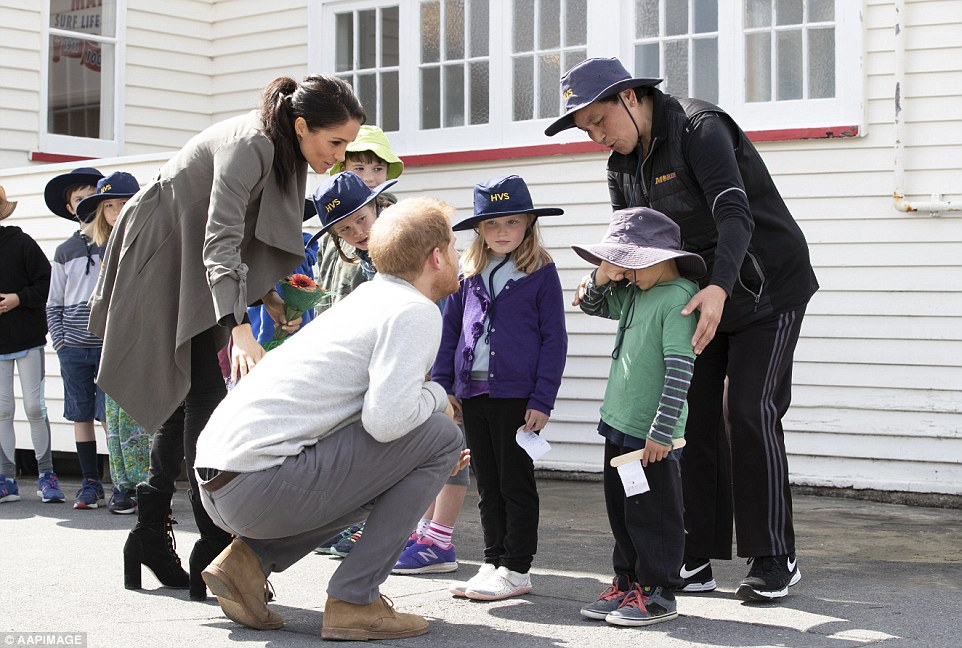 Meghan Markle and Prince Harry appear poised to become perfect first time parents taking the time to comfort a shy child who broke down in tears ahead of meeting them