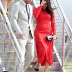Meghan Markle arrived in Tonga with Prince Harry in a Self Portrait dress Image WIRE IMAGE