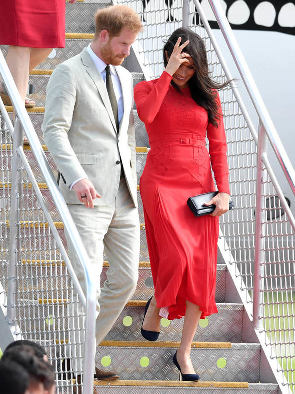 Meghan Markle dazzled in a stunning red dress as she landed in Tonga Image Getty