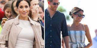 Meghan Markle clutches her baby bump during her 16 day Australia tour Image GETTY