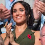 Meghan Markle is proudly wearing a remembrance poppy on her green top Image PA