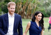 Meghan Markle surprises by taking out her mobile phone during engagement Photo C GETTY