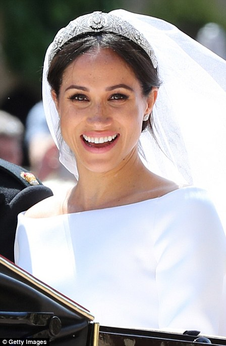 Meghans sparkling tiara is Queen Marys Diamond Bandeau which has been loaned to her by Harrys grandmother the Queen