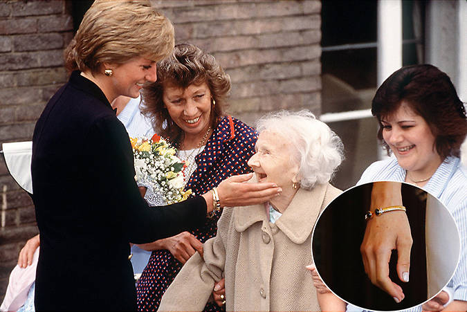 Meghan also wore a bracelet that once belonged to Princess Diana seen here showing it off during a visit to The Lord Gage Centre Photo C GETTY IMAGES