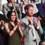 Meghan and Harry cheering at the athletes taking the floor at the closing ceremony Image GETTY