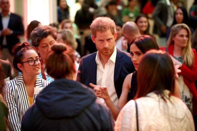 Meghan and Harry looked to be deep in conversation with the young guests at the event We wonder what the Duchess is saying Photo C GETTY IMAGES