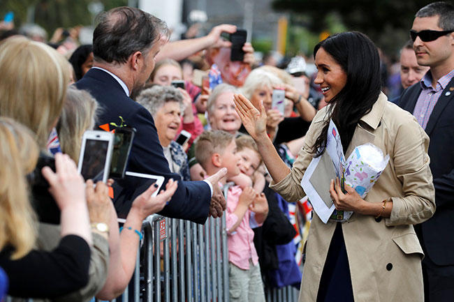 Meghan and Harry recieved gifts from well wishers during their walkabout Photo C GETTY