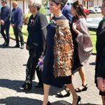 Meghan arriving in her Stella McCartney dress and a woven Korowai Māori cloak Photo C GETTY