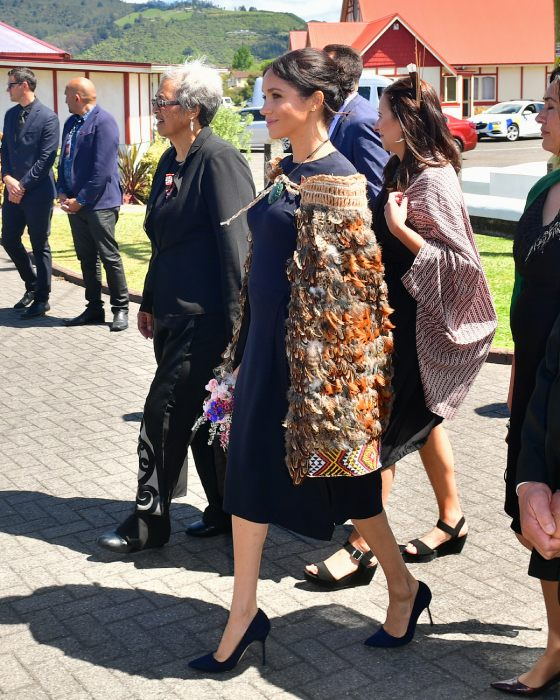 Meghan arriving in her Stella McCartney dress and a woven Korowai Māori cloak Photo C GETTY