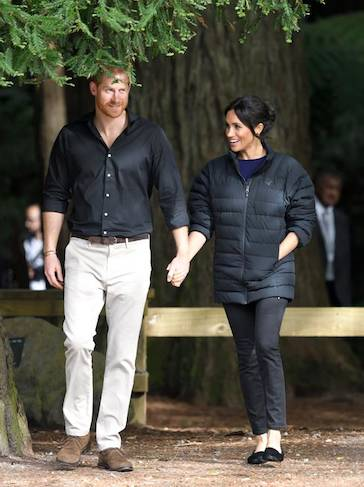 Meghan did a quick change into a more casual set of clothes exploring the forest in flat shoes and a warm puffa jacket Photo C GETTY 1