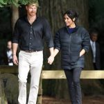Meghan did a quick change into a more casual set of clothes exploring the forest in flat shoes and a warm puffa jacket Photo C GETTY