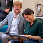 Meghan laughed with joy as she received the gift Photo (C) GETTY