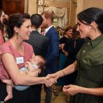 Meghan spoke to Australian Singer Missy Higgins with her nine week old baby Lunar who slept soundly during an afternoon reception on the first day of their royal tour