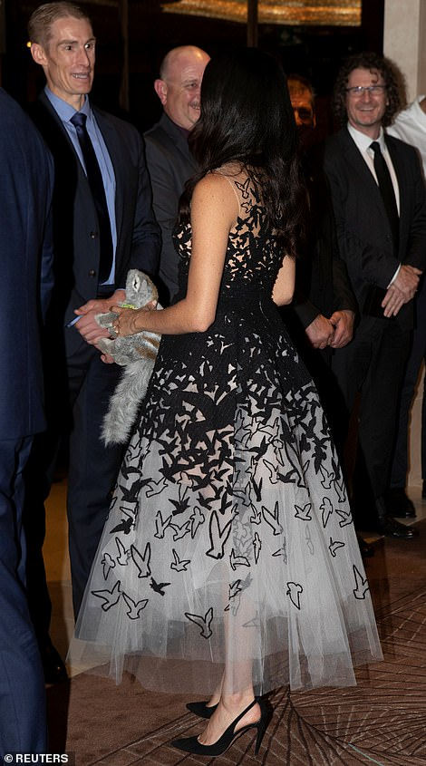 Meghan was clutching a toy wombat that she had been given for her unborn baby